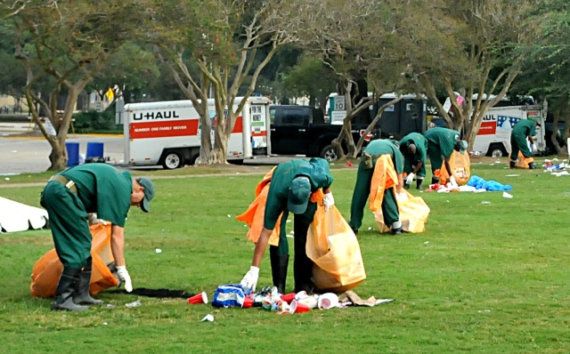 Louisiana prison inmates pick up game-day trash on the Parade Ground Sunday, Oct. 14, 2012, after LSU played South Carolina in Tiger Stadium. (Benjamin Oliver Hicks, LSU Daily Reveille)