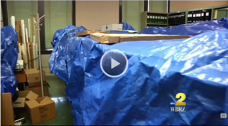 Blue tarps cover maps at LSU Cartographic Information Center. (WBRZ screen shot)