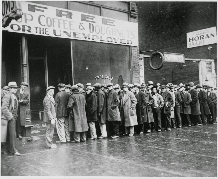 The unemployed line up outside a soup kitchen opened in Chicago by Al Capone in 1931.