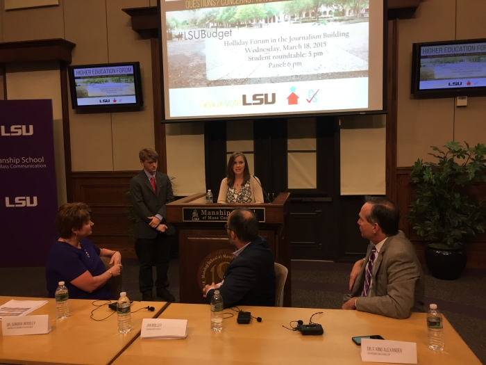 Louisiana higher education leaders listen on Wednesday night as LSU student pose question about threatened budget cuts.
